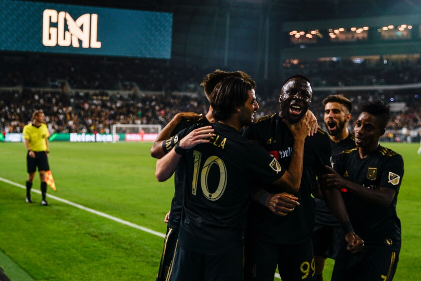 LAFC teammates celebrate a goal during a match against the Galaxy at Banc of California Stadium on Oct. 24, 2019.