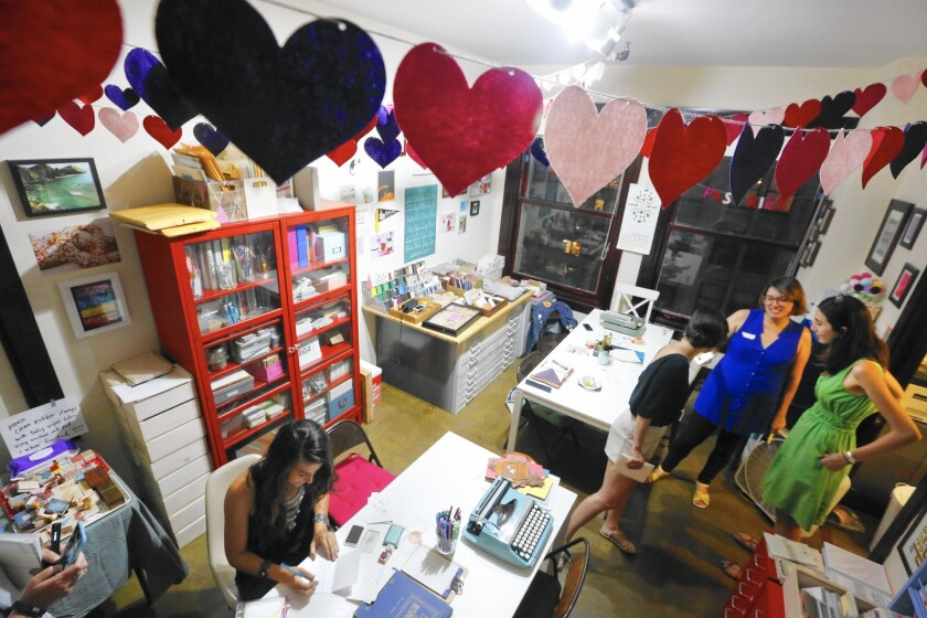Megan Johnson, left, of Los Angeles, writes a letter to her mom, who lives in North Carolina, at a gathering of the L.A. Penpal club at Paper Pastries Atelier in downtown Los Angeles.