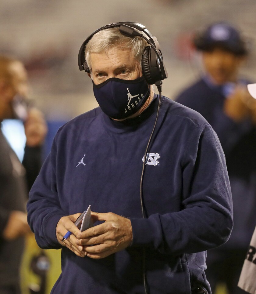 "FILE - In this Oct. 31, 2020, file photo, North Carolina coach Mack Brown watches a play during the team's NCAA college football game against Virginia, in Charlottesville, Va. The ACC hosted a Mental Health and Wellness Summit in 2019 in Durham, North Carolina. A second one was planned for last May before being scuttled by the pandemic. ""Many years ago, we didn't say much about it (mental health) at all,"" North Carolina coach Mack Brown said. Now, it's a frequent topic. (Andrew Shurtleff/The Daily Progress via AP, File)"