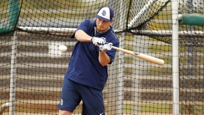 Alex Dickerson takes batting practice before spring training began.
