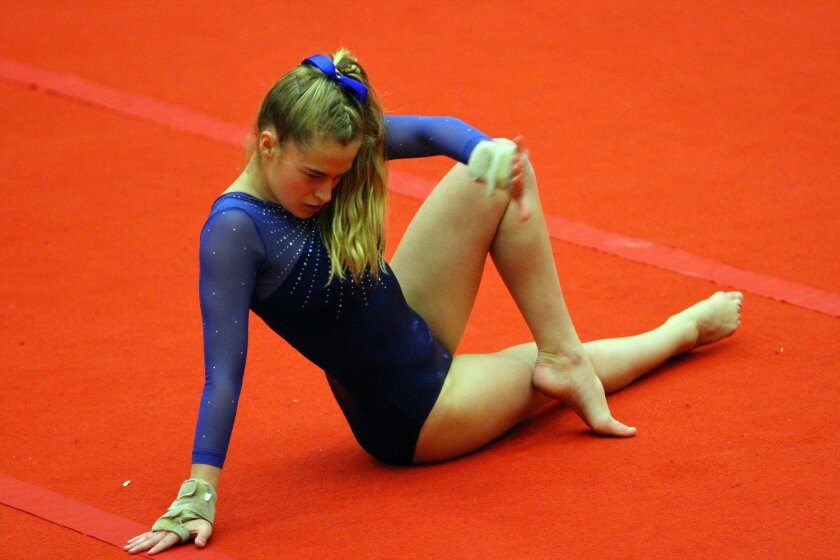 Kaylee Helmbacher of La Costa Canyon performs her floor exercise routine Saturday during the Sundevil Invitational at Mt. Carmel. The Mavericks won the team title.