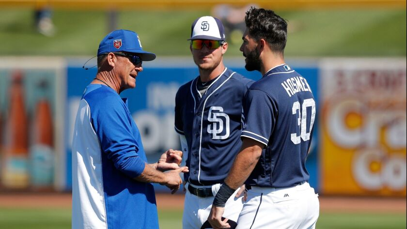 Kansas City Royals Vice President of Baseball Operations George Brett, left, talks with Padres Eric Hosmer, right, and Wil Myers, center, before the teams played Friday.