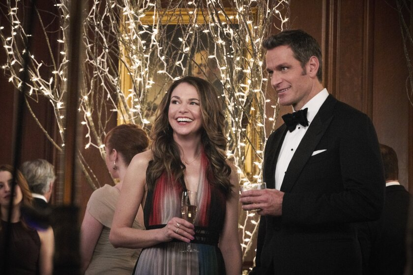 """Sutton Foster, as Liza, and Peter Hermann, as her love interest Charles, enjoy a drink at a gala event in """"Younger."""""""