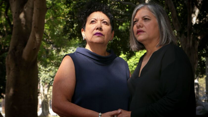 Judith Dominguez, left, and wife Patricia Martinez of Alhambra say Colorado-based Cherry Creek Mortgage refused to provide them spousal health insurance coverage because of their sexual orientation.