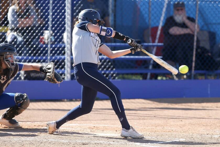 Newport Harbor's Eliana Gottleib drives the ball for a single during Wave League softball game again