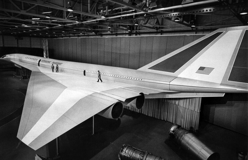 June 27, 1966: Three technicians walk on the left delta wing of the full scale mockup of Lockheed su