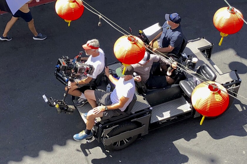Film crews work in close quarters operating high-touch equipment.