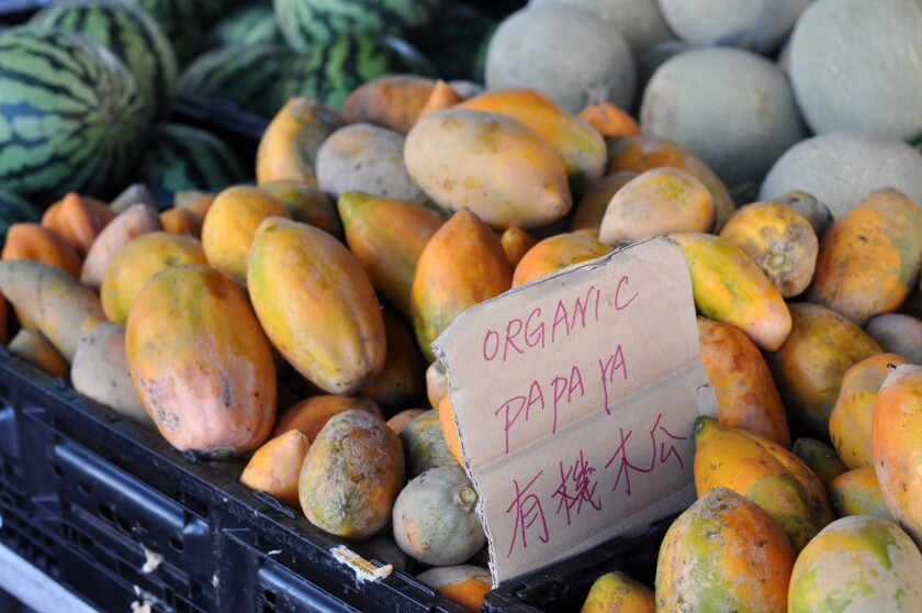 Organic papayas on a table at the Alhambra farmers market