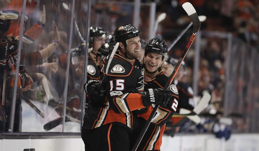 Ducks' Ryan Getzlaf, left, celebrates his goal with Kevin Bieksa during the second period against the Tampa Bay Lightning on Tuesday.