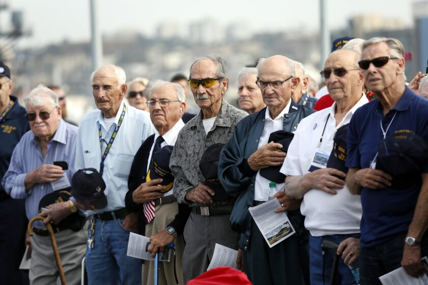 """Hundreds attended the 70th anniversary Memorial service for """"Taffy 3"""" Battle off Samar aboard the USS Midway on Saturday morning. Fifty-five survivors, family members and others filled the flight deck for the ceremony."""