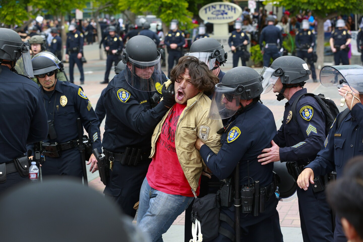 A protester who refused to comply with San Diego police officers in the Gaslamp Quarter was taken into custody on Friday.