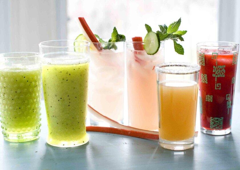 This April 28, 2014 photo shows, from left, green granny slush, cucumber rhubarb mojito, ruby rita, and raspberry daiquiri drinks in Concord, N.H. (AP Photo/Matthew Mead)