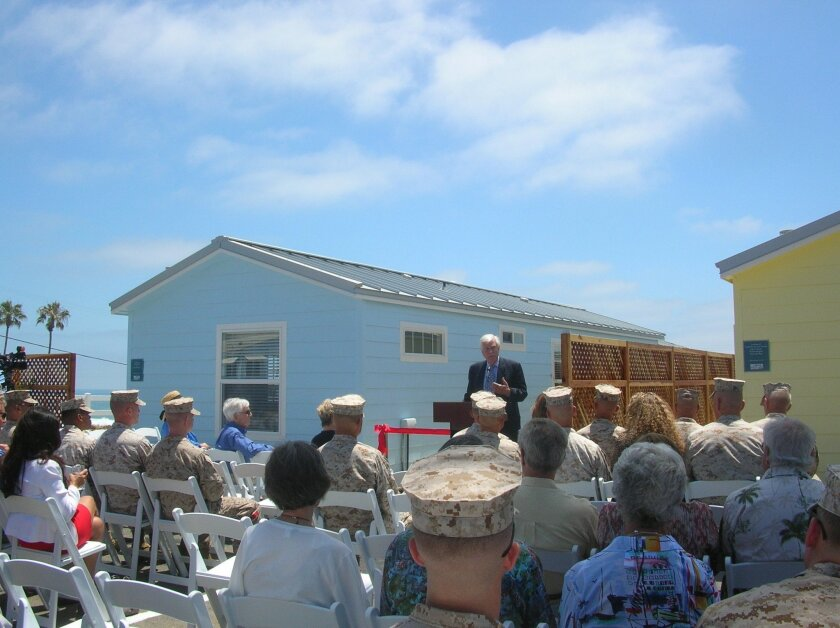 Bob Clelland speaks at the dedication of five newly built beach cottages that troops and their families can rent for seaside holidays funded by community members.