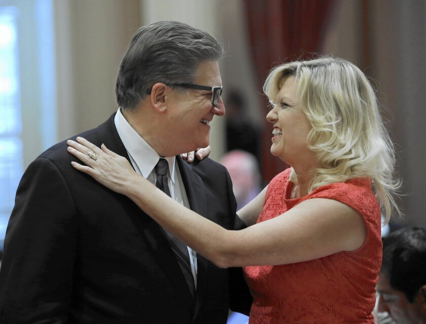 State Sen. Bob Hertzberg (D-Van Nuys) and Cathleen Galgiani (D-Stockton) greet each other as lawmakers return Monday to the Capitol after their summer recess.