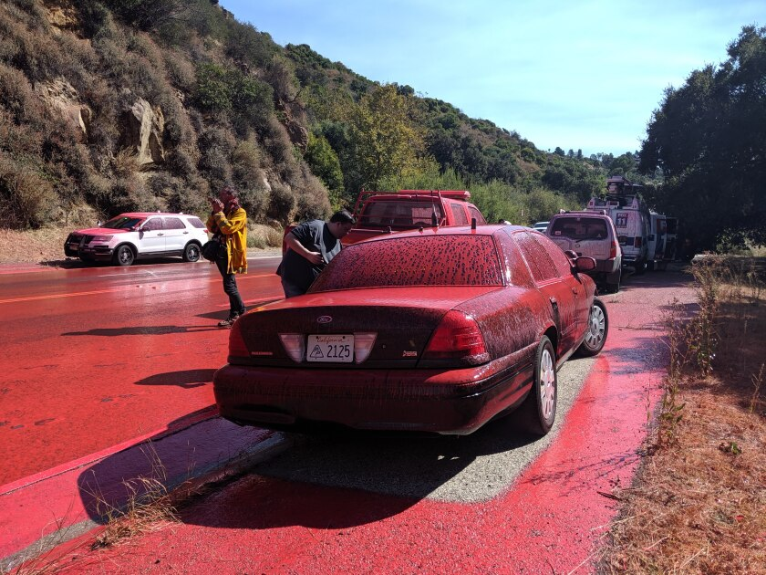 Retardant on a car near Pacific Palisades fire