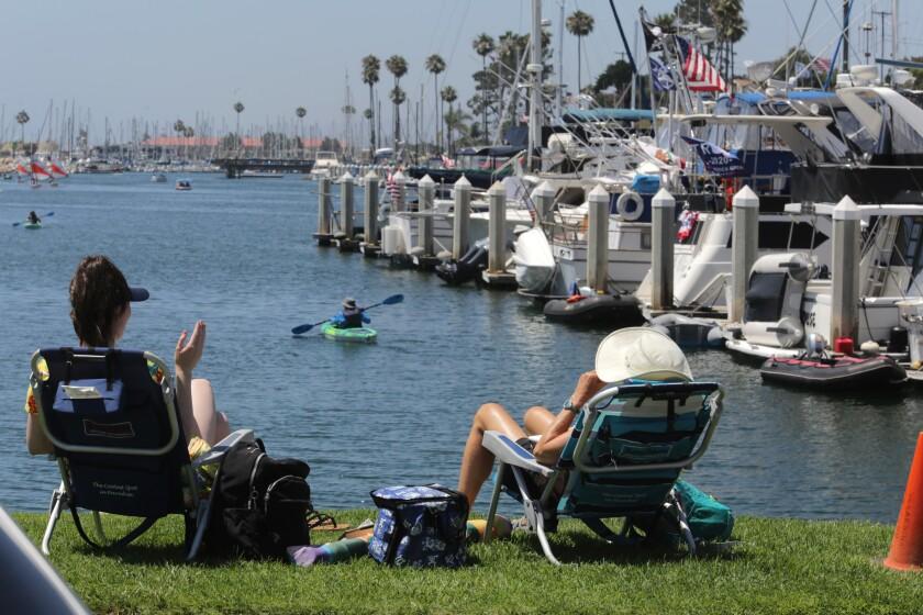 Visitors enjoy the Oceanside Harbor in July 2020.