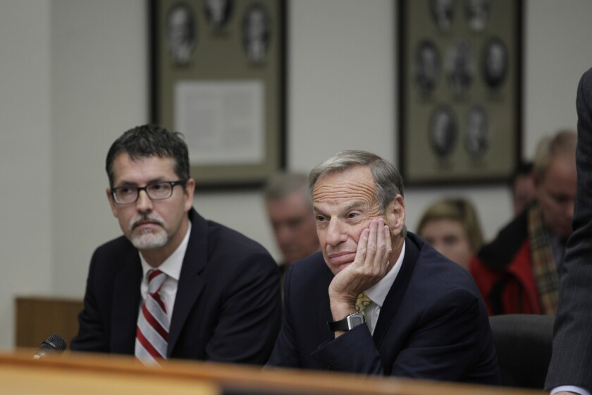 Former San Diego Mayor Bob Filner, right, sits with Earll Pott, a member of his defense team, in Superior Court Judge Robert J. Trentacosta's courtroom on Monday. Filner was sentenced to three months of home confinement and three years of probation for harassing women while he was mayor of San Diego.