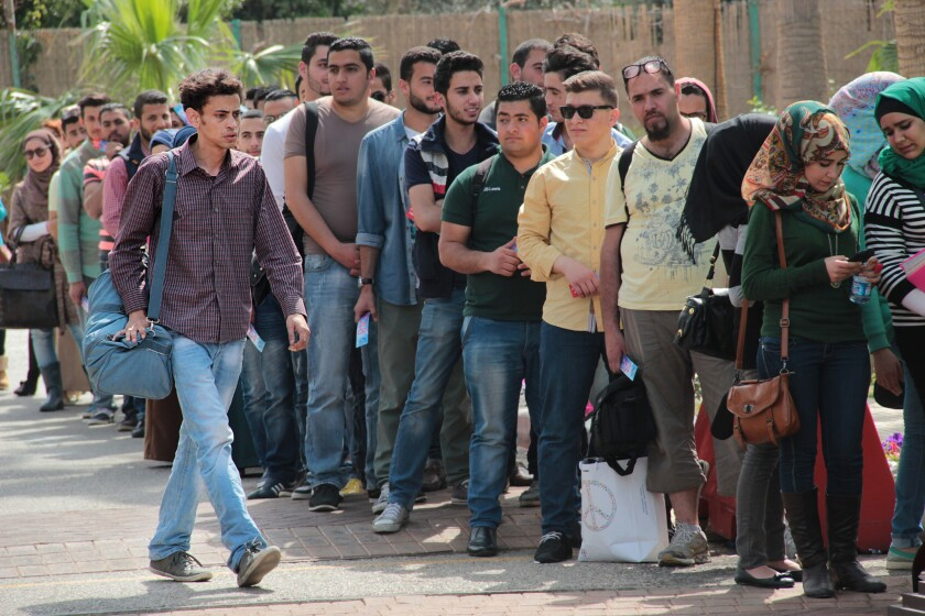 """Mohammah Assaf (Tawfeek Barhom) walks to the head of the line of aspiring artists hoping to land a competition slot on """"Arab Idol,"""" in a scene from Hany Abu-Assad's """"The Idol."""""""