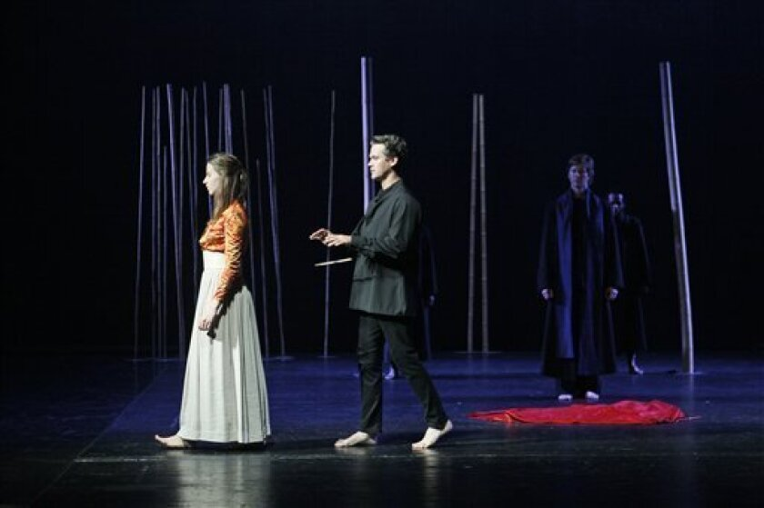 """In this July 5 2011 photo, Jeanne Zaepffel, performs as Pamina alongside Adrian Strooper performing as Tamino during a photo call of the 2011 Lincoln Center Festival Peter Brook production of """"The Magic Flute"""" in New York. (AP Photo/Mary Altaffer)"""