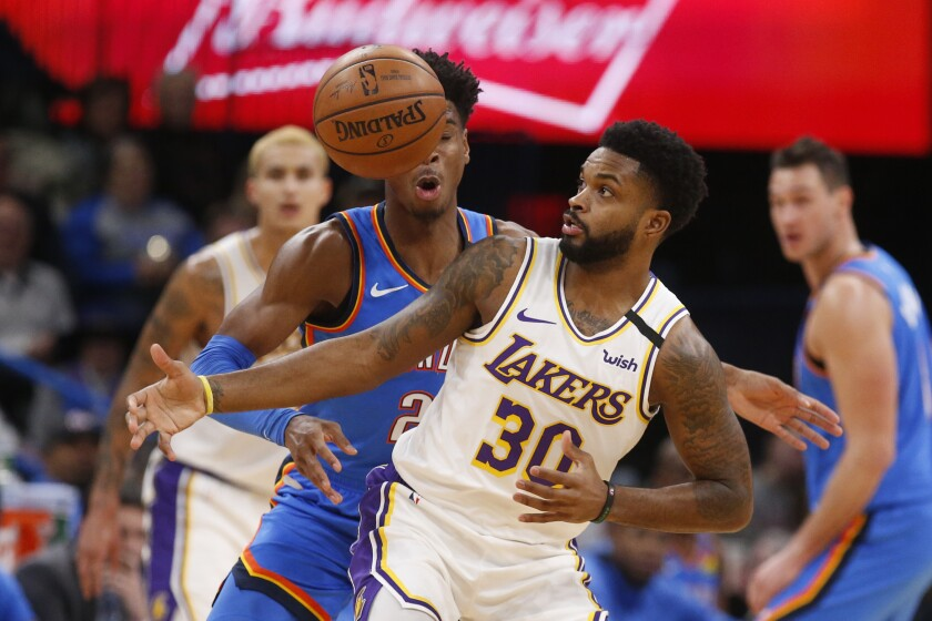 Oklahoma City's Shai Gilgeous-Alexander (2) knocks the ball away from Lakers guard Troy Daniels on Jan. 11.