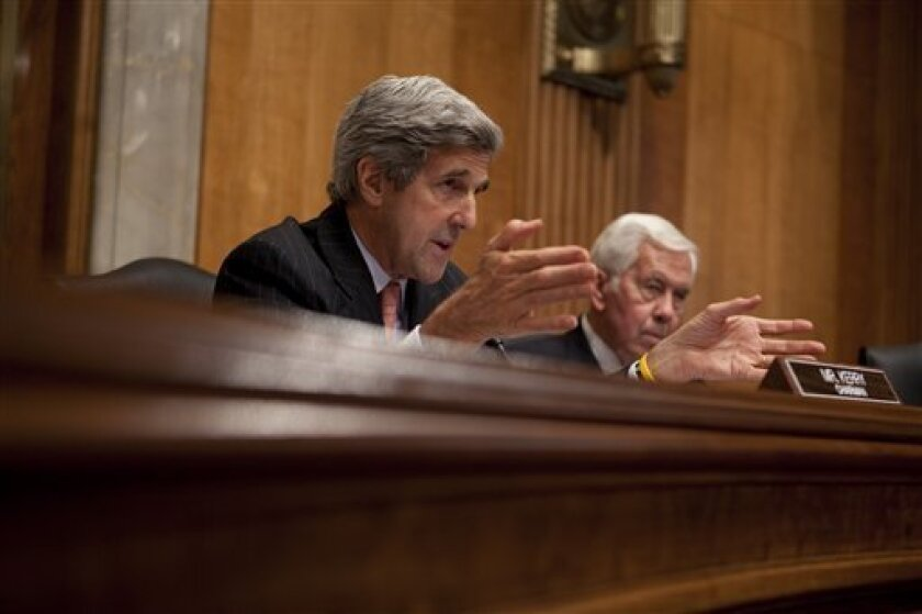 Senate Foreign Relations Committee Chairman Sen. John Kerry, D-Mass., left, and the committee's ranking Republican Sen. Richard Lugar, R- Ind., take part in the committee's hearing on the Al-Qaeda threat in Pakistan and Afghanistan, Wednesday, Oct. 7, 2009, on Capitol Hill in Washington. (AP Photo/Evan Vucci)