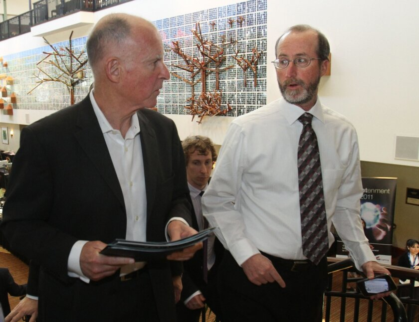FILE -- In this April 5, 2011 file photo Gov. Jerry Brown, left, talks with adviser Steve Glazer, after making a speech in Sacramento, Calif.   Glazer, currently the Mayor of Orinda, and Democratic challenger, Assemblywoman Susan Bonilla, of Concord, faced off in a special election to fill the 7th