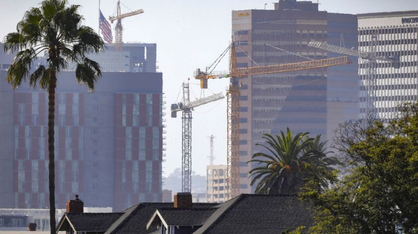 SAN DIEGO, CA 9/12/2018: Construction cranes in downtown San Diego reflect the development going on.
