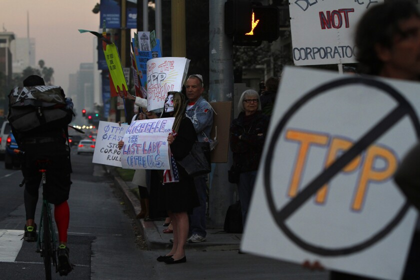 Activists demonstrate against the Trans-Pacific Partnership on Wilshire Boulevard in Los Angeles.