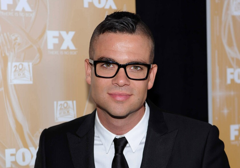 """Glee"" actor Mark Salling arrives at the Fox Emmy party in West Hollywood on Sept. 18, 2011. He was found dead of an apparent suicide Tuesday morning."