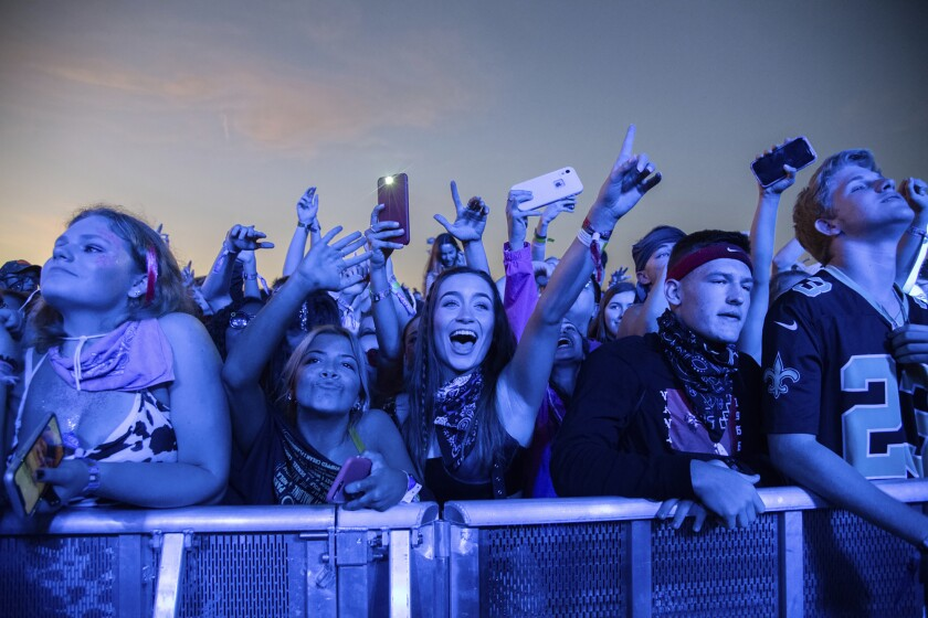 Festival-goers attend the Voodoo Music Experience in New Orleans