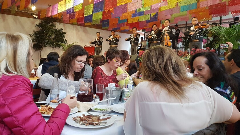 Diners eat lunch while a mariachi band plays at Arroyo Restaurant in Mexico City on Sunday.