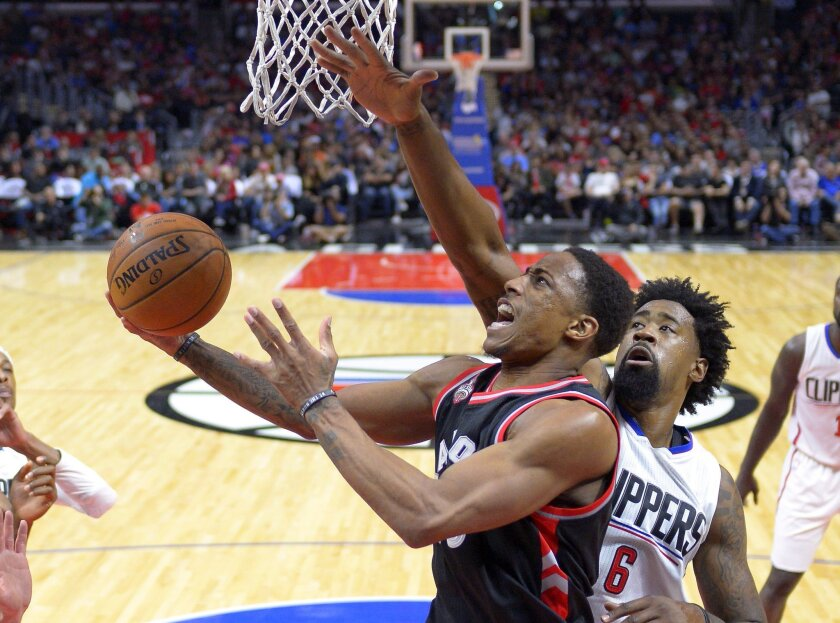 Toronto Raptors guard DeMar DeRozan shoots as Los Angeles Clippers center DeAndre Jordan defends during the first half of an NBA basketball game Sunday, Nov. 22, 2015, in Los Angeles. (AP Photo/Mark J. Terrill)