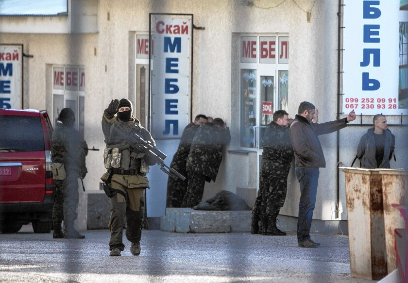 """Russian forces arrest Ukrainian army officers in Simferopol, Crimea's capital. In Moscow, Russian President Vladimir Putin justified the takeover of Crimea as fulfilling Russia's """"historic legacy."""""""