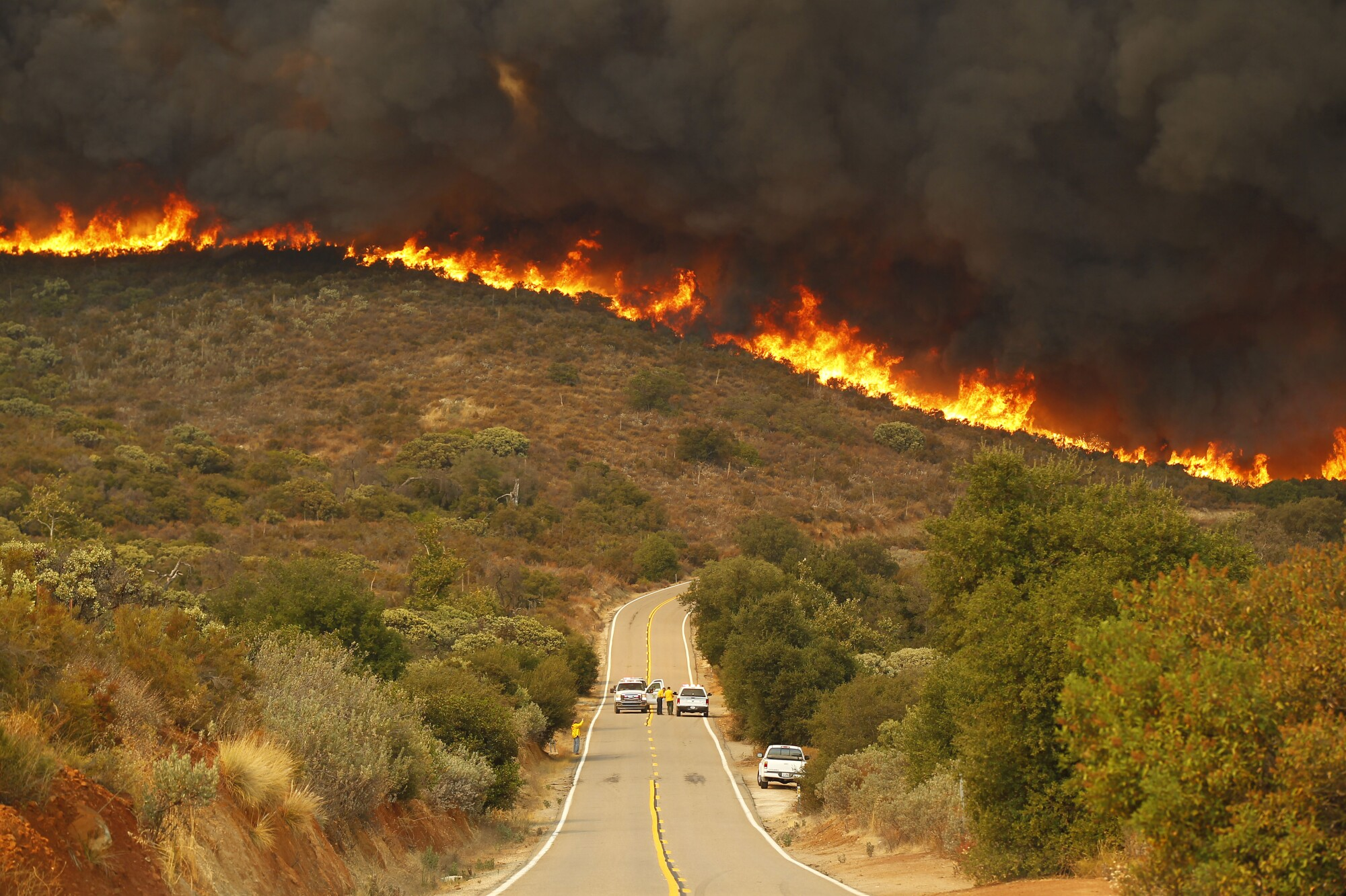 San Diego Sheriffs and CDF firefighters stage on Lyons Valley Road during the Valley fire.