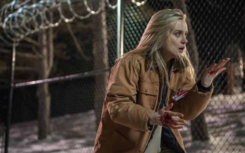 "Taylor Schilling stars in Netflix's ""Orange Is the New Black."""