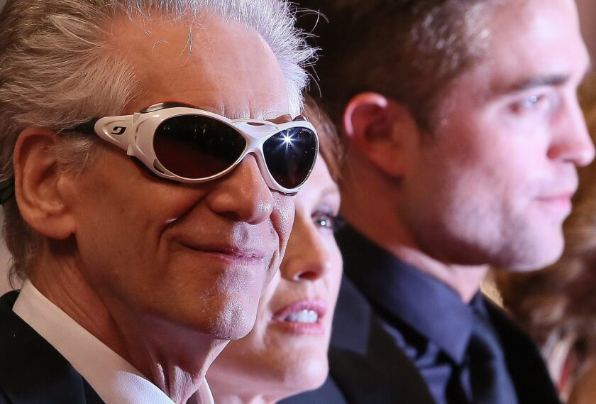 """David Cronenberg, left, arrives for the screening of """"Maps to the Stars."""""""