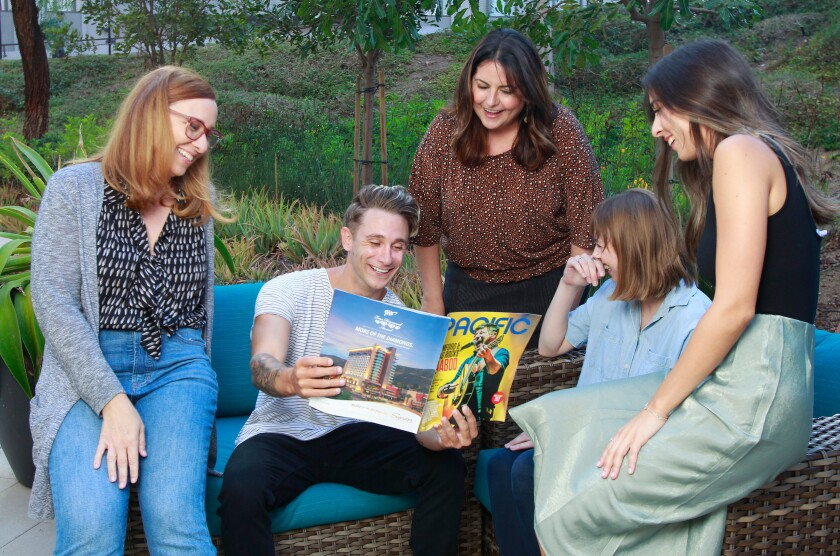 The team of PACIFIC Magazine reads the September 2019 issue together. (Not pictured: Katie Musolf)