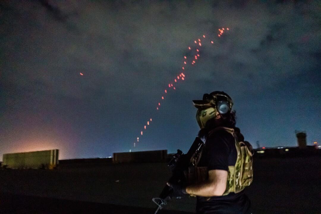 Celebratory gunfire lights up the sky