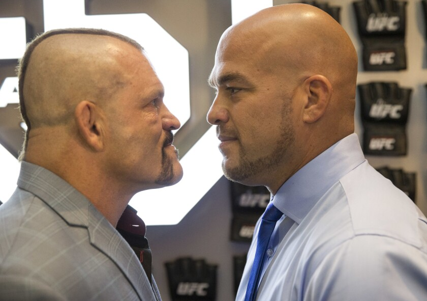 Mixed martial arts fighters Chuck Liddell, left, and Tito Ortiz face off during a red carpet event ahead of the UFC Hall of Fame ceremony at The Pearl at the Palms in Las Vegas on Thursday, July 5, 2018. (Richard Brian/Las Vegas Review-Journal via AP)