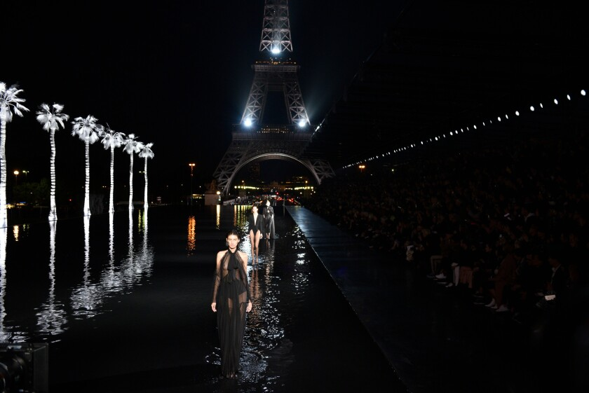 The finale of the Saint Laurent spring and summer 2019 women's runway show was presented Tuesday at the Trocadéro fountain during Paris Fashion Week.