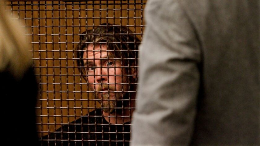 A suspect waits to be arraigned in Los Angeles Superior Court in San Fernando, Calif. on April 3, 2013.