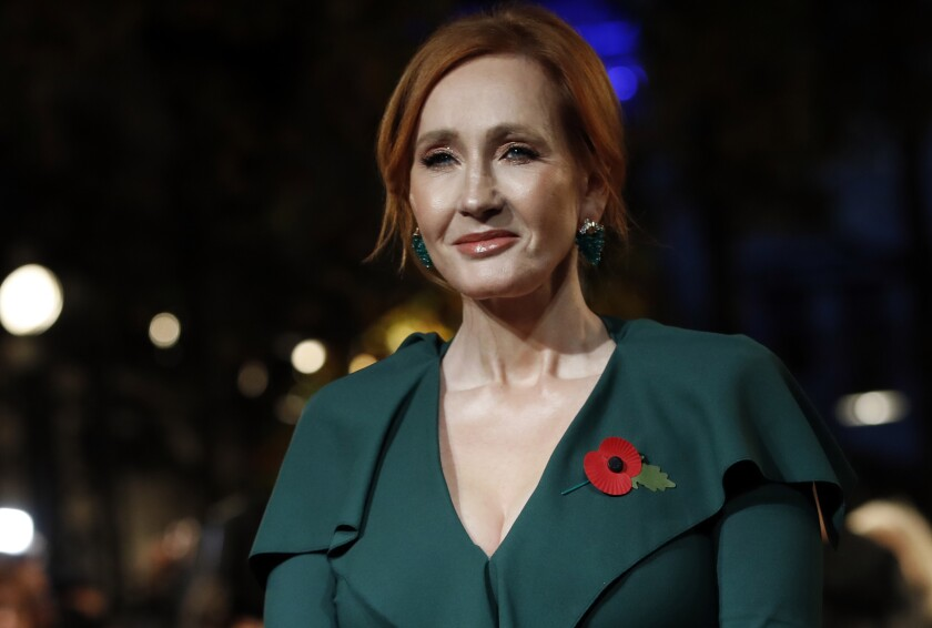 """FILE - Author J.K. Rowling appears at the world premiere of the film """"Fantastic Beasts: The Crimes of Grindelwald"""" in Paris on Nov. 8, 2018. Scholastic announced Tuesday that Rowling's """"The Christmas Pig,"""" the story of a boy named Jack and a beloved toy (Dur Pig) which goes missing, will be released worldwide Oct. 12. (AP Photo/Christophe Ena, File)"""