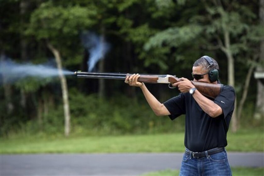 In this photo released by the White House, President Barack Obama shoots clay targets on the range at Camp David, Md., Saturday, Aug. 4, 2012. The White House released a photo of Obama firing a gun, two days before he heads to Minnesota to discuss gun control. In a recent interview with The New Rep