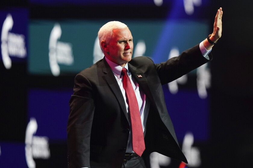 Vice President Mike Pence waves as he walks off the stage after speaking at the Turning Point USA Student Action Summit, Tuesday, Dec. 22, 2020, in West Palm Beach, Fla. (AP Photo/Lynne Sladky)