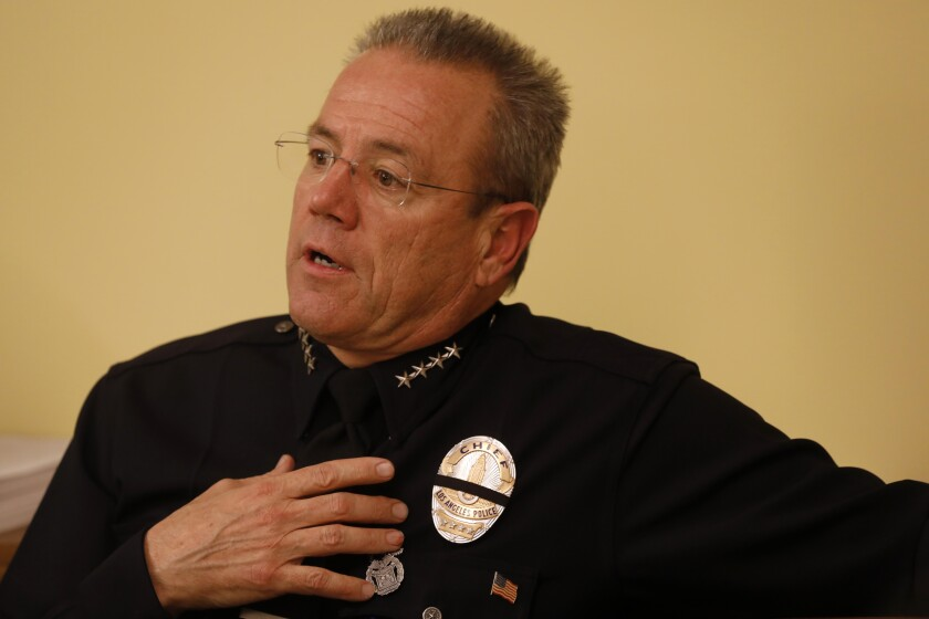 LAPD Chief Michel Moore discusses the LAPD gang-framing scandal with the Cease Fire collective, which includes community leaders, parents, gang interventionists and other members of law enforcement, on Jan. 11.