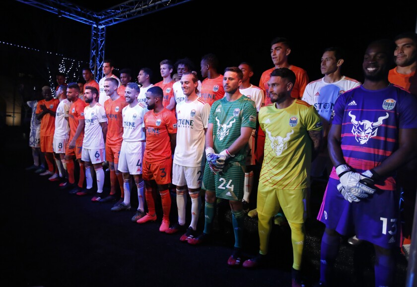 The San Diego Loyal soccer team unveiled their orange and white with green trim uniforms in Liberty Station on Feb. 13, 2020. The goalies are at right.