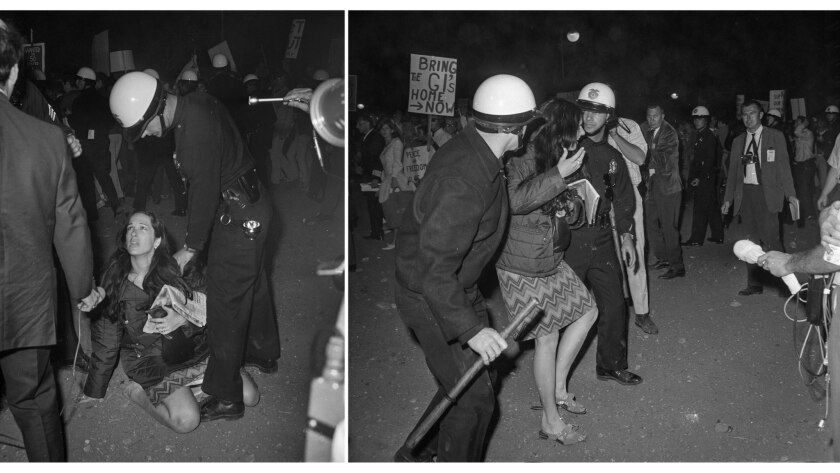 June 23, 1967: A protester is removed from Century Plaza during a speech by President Lyndon Johnson