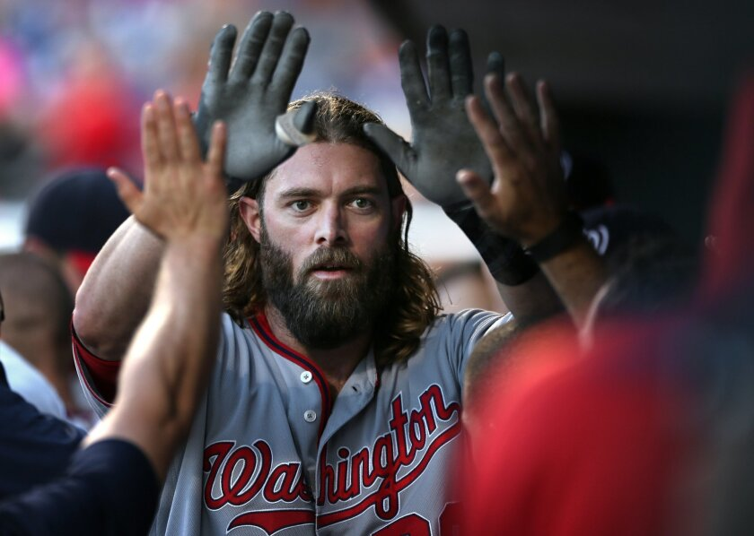 Washington Nationals' Jayson Werth is congratulated in the dugout after hitting a home run off Philadelphia Phillies' Aaron Nola during the first inning of a baseball game, Tuesday, May 31, 2016, in Philadelphia. (AP Photo/Laurence Kesterson)