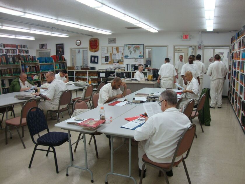 Students work in the seminary library at the state prison in Rosharon, Texa