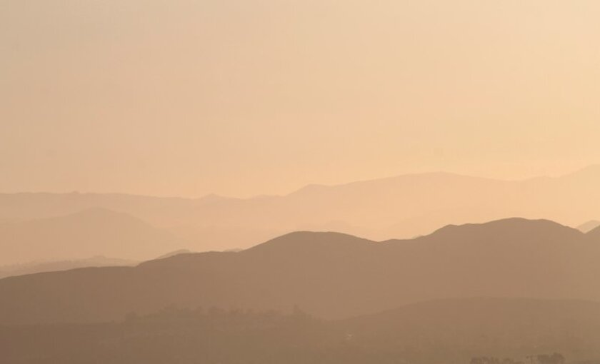 The offshore winds have been kicking up dust and haze across inland San Diego County.